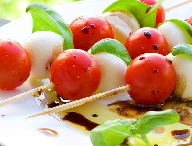 The mini Caprese skewers made of boccacini cheese, round tomatoes and basil are served on a white plate at the Tandoor & Grill Restaurant at the Stanford Fernie Resort.