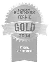 A winner's ribbon in grey of the gold award for best ethnic restaurant of 2014 in the Kootenays, BC for Tandoor & Grill, the onsite restaurant at the Stanford Fernie Resort.