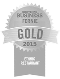 A grey icon of a winner's ribbon for the gold award for best ethnic restaurant of 2015 in the Kootenays is awarded to the Tandoor & Grill, the onsite restaurant at the Stanford Fernie Resort in BC.